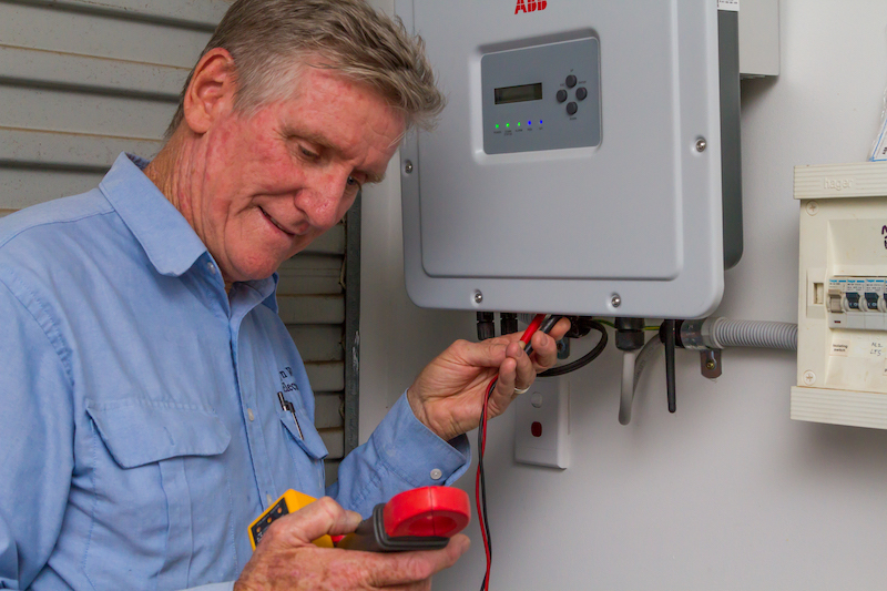An electrician checking on an electrical switchboard. Never DIY your electrical work. Contact a licensed electrical contractor in Bardon and surrounds (Alderley, Ashgrove, Enoggera, Paddington, The Gap) like Allyn White Electrical for all of your electrical problems.